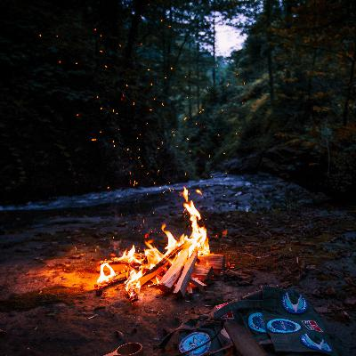 Camping by the River: Crackling fire and river sounds
